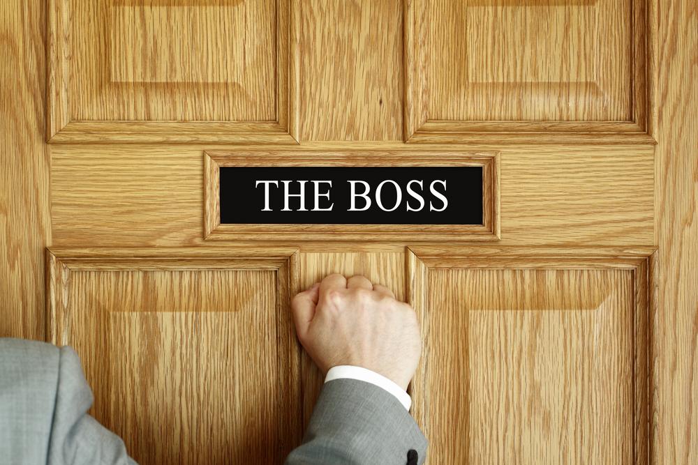 Hand knocking on the boss' door